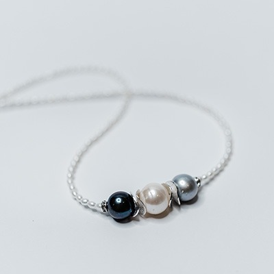2-3mm White fresh water tiny pearls with three multi colour centre arrangement. R1200.00
