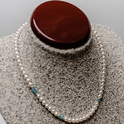 5.5-6mm Round fresh water pearl, complemented with abstract apatite stone arrangement. Price: 895.00