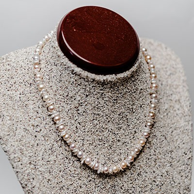 Peach Fresh Water Pearls with Champagne keshi pearl Arrangement. Price: R695.00