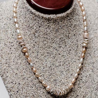 Peach fresh water pearl with champagne keshi pearl arrangement. Price: R695