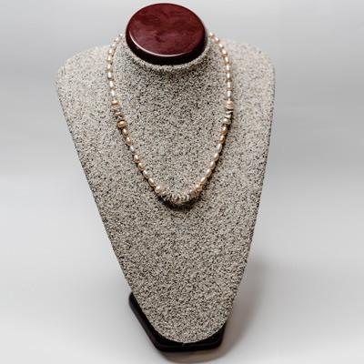 Peach fresh water pearl with champagne keshi pearl arrangement. Price: R695.00